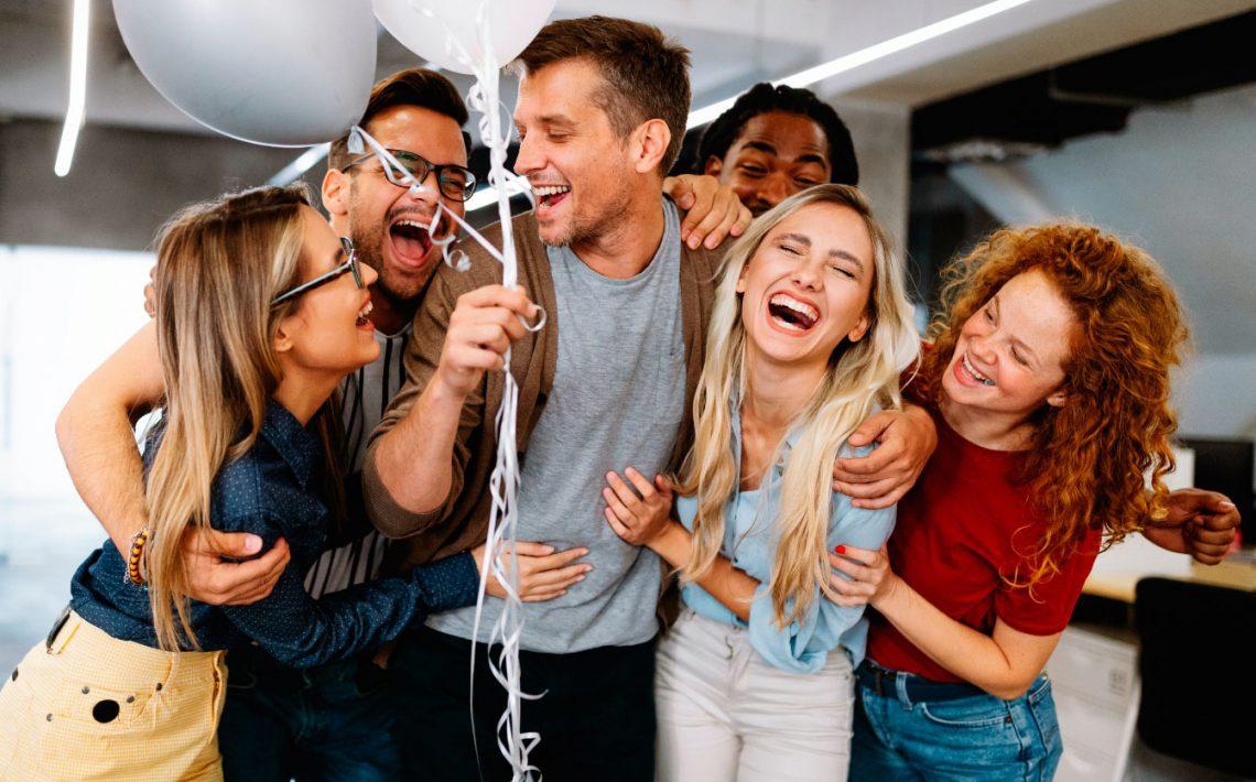 happy-business-people-celebrating-success-at-compa-K6SJ6C8.jpg